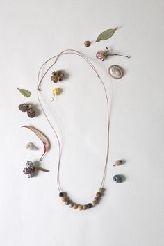 Grampians Necklace This limited edition necklace features 12 handmade ceramic beads that are hand formed using found clay and pit fired with wood, ...