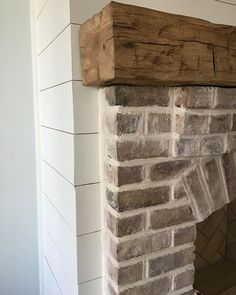 whitewashed brick; rustic wood mantel; shiplap