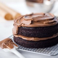 "Double-Chocolate Layer Cake | ""This is the most fabulous chocolate cake that I've ever made,"" says Ina Garten, host of Food Network's Barefoot Contessa. ""It's so easy and so moist and light. There's buttermilk and a cup of coffee in the batter! The frosting is just buttercream and a little coffee."""