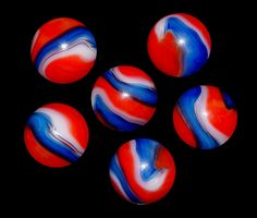 Red, white, and blue vintage Akro Agate marble .. nice patriotic marble!
