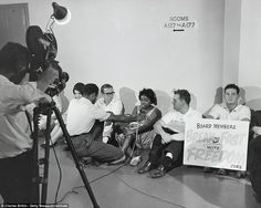 News media interviewing CORE activists waging a sit-in and hunger strike outside the Los Angeles Board of Education offices to raise awareness of segregation and inequality in the public schools in 1963