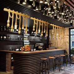 such a cool bar, thanks to the lighting Coffee Shop Interior Design, Coffee Shop Design, Restaurant Interior Design, Cafe Design, Industrial Chandelier, Pendant Lighting, Rope Pendant Light, Rope Lighting, Rustic Lighting