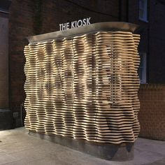 Microscopic views of flower petals informed the ripple timber facade of this flower kiosk in west London by British firm Archio Ltd.