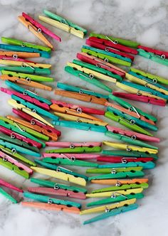 Two-Tone Tie-Dye Clothespins. I am crazy about this idea! (Would also work great for #Passover with 1 of our Passover Seder Steps Follow-Along art ideas -- to hang the Seder Steps around your room. http://www.amazon.com/Jewish-Holidays-in-Box-Follow-Along/dp/B00IKGMOC8/ref=sr_1_1?ie=UTF8&qid=1401800445&sr=8-1&keywords=passover+seder+steps