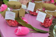 Popcorn favors in burlap topped mason jars! See more party planning ideas at CatchMyParty.com!