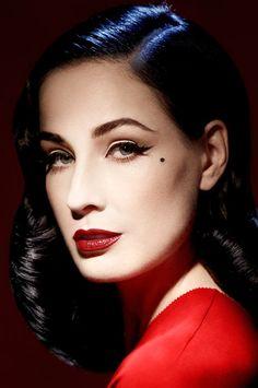 Burlesque star Dita Von Teese in red dress & crimson lipstick.