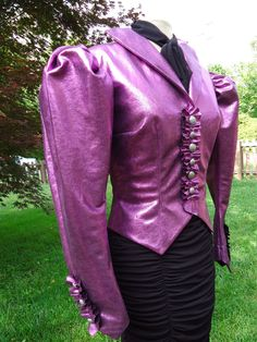 Hunger Games Effie Trinket costume Neo Victorian Futuristic violet metallic fitted jacket with huge sleeves. $95.00, via Etsy.