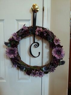 Great wreath with initial.