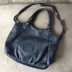 Marc by Marc Jacobs Electro Q Fran Gorgeous leather bag not one single flaw . I've had this as my basic black bag for over a year and it barely shows any wear . The rolled handles are indestructible . Marc by Marc Jacobs Bags