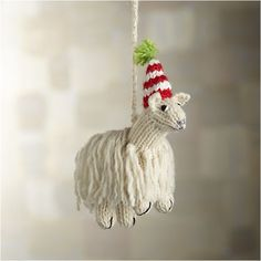 Our fluffy llama ornament dons a seasonal stocking cap, adding winter charm to the tree. Made of soft alpaca and wool, this ornament was handcrafted exclusively for Crate and Barrel through an artisan group in Peru that empowers men and women to earn a fair and sustainable income, providing community development, education and healthcare.