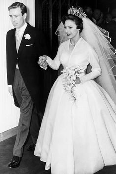 The two were married in Westminster Abbey on May 6. Princess Margaret wore Norman Hartnell, couturier to the royals, and the Poltimore Tiara.