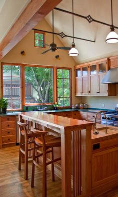 Lyptus, a hard and eco-friendly type wood equivalent to maple, was used in the remodeling of this kitchen as it is durable and resistant to dings and dents. Designed by HartmanBaldwin Design/Build