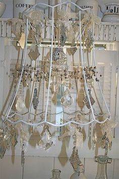 My homemade chandelier using strings of pearls crystals and an old my homemade chandelier using strings of pearls crystals and an old lampshade frame fixed together with my glue gun cheap and cheerful keyboard keysfo Choice Image