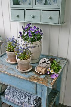 Potted plants aswell as cut flowers could be lovely- forget me nots on tables would be pretty