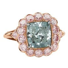 David Rosenberg 4.16ct Fancy Intense Blueish Green Cushion Cut Diamond Ring | From a unique collection of vintage engagement rings at https://www.1stdibs.com/jewelry/rings/engagement-rings/