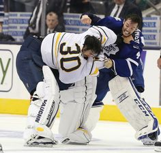 Did we say goalie fight? Buffalo Sabres goalie Ryan Miller and Toronto Maple Leafs goalie Jonathan Bernier fight in the third period as the Toronto Maple Leafs beat the Buffalo Sabres in preseason action. Go Leafs Go! Hockey Goalie, Hockey Mom, Hockey Teams, Soccer, Red Wing Players, Ryan Miller, Steve Yzerman, Different Sports, Buffalo Sabres