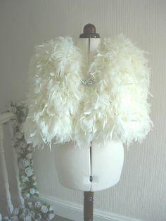 Handmade Chandelle Feather Bridal Shrug Winter Wedding Cape. $405.00, via Etsy.