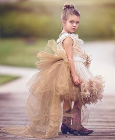 Dramatic and dreamy, this fantastic party dress from Love Baby J is a timeless style for any special event. The lavish bodice is made of luxurious soft and cozy minky fur fabric and is adorned with a