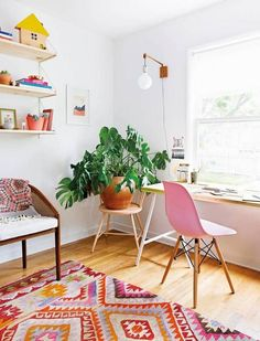 A home workspace bathed in color and natural light.