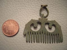 A resized image of Baltic Copper Alloy Comb Pendant of Medieval Date:  Obverse