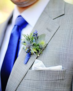 Joe loves the idea of grey tux's for him and the groomsmen. The boutonniere we were thinking about was a blue/purple orchid that would match my bouquet.