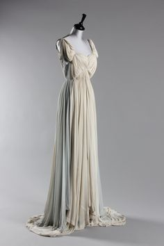 A Madame Gres ivory and dove-grey draped jersey evening gown, 1940s