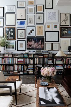 A light living space in Venice, California is packed with artwork and books