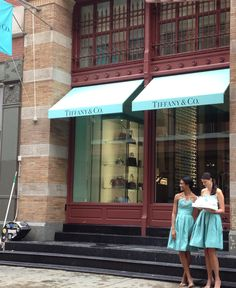 Tiffany's awnings and dresses to match!  Designed and fabricated by Hudson Awning & Sign Co.