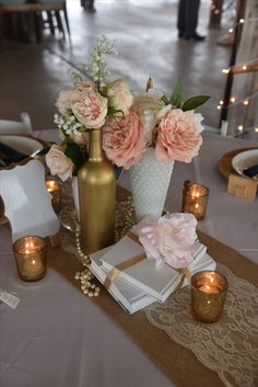 Vintage, elegant table design, milk glass, hobnail glass, peach rose, peach peony, gold wine bottles, dripping pearls, painted stacked books, gold votives, ivory lace and burlap runner, Wishing Well Barn