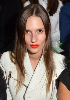 Not a red lips girl? Buck expectation and opt for bright orange lipstick like model Cate Underwood | 15 Cool Holiday Beauty Looks for 2015