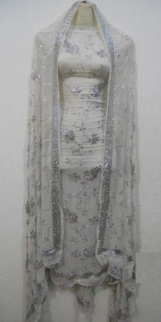 A Beautiful Design of Mukesh (Kamdani) work on Pure China Crinkle.