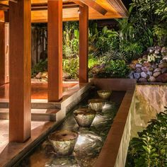 Stone water feature from traditional cooking pots. The lobby entry at Villa…