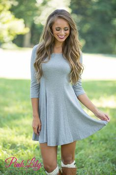 The versatility of this simple dress is out of this world! There are so many ways you can rock this heather grey dress that will make it pop all year long!