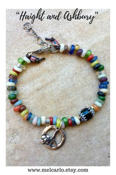 A variety of colorful glass beads from Java join with a black and white Venetian Chevron Trade Bead to make this everyday bracelet to wear alone or stacked with other bracelets. #haightandashbury #sanfrancisco #hippie #hippiejewelry #bohostyle #bohemian #sundance