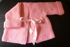 Handmade knitted baby girls pink matinee jacketed by BulldogKnits