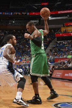 Rajon Rondo sizes up the Magic's Jameer Nelson. (January 19, 2014 | Boston Celtics @ Orlando Magic | Amway Center in Orlando, Florida)