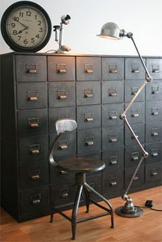 Rejuvenation Industrial: nice array of industrial-inspired items - clock, stool, articulated floor lamp - not to mention the file cabinet!