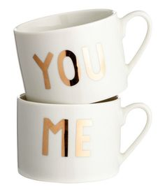 White/text. Porcelain mugs with a gold-colored printed text design. Height 2 1/2…
