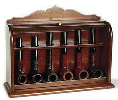 Rolltop rack of unsmoked Dunhill pipes from 1939.: