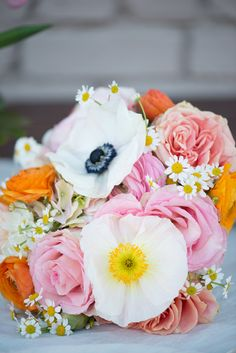 gorgeous colors for spring, with our beloved #anemones and #poppies - floral design by Bella Calla, photo by Jordan Weiland http://www.ruffledblog.com/spring-floral-inspiration/