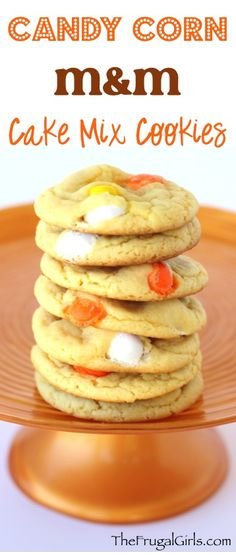Candy Corn M&M Cake Mix Cookie Recipe! ~ from TheFrugalGirls.com ~ these easy Cake Mix Cookies are SO delicious and super easy to make - perfect for your Fall Parties! #cakemix #recipes #thefrugalgirls