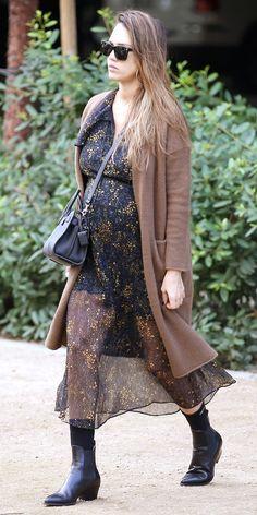 Over the weekend, Jessica Alba flaunted her growing baby bump while wearing a floral dress. The expectant mother also showed off a hint of skin with sheer details, but she was able to keep warm thanks to a cozy coat and leather boots. Fall Maternity Outfits, Pregnancy Outfits, Maternity Fashion, Maternity Styles, Pregnancy Style, Maternity Swimwear, Pregnancy Photos, Jessica Alba Style, Prep Style