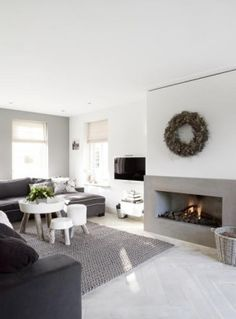 contemporary living room in white and grey with rustic elements incl' pretty wreath - Haard 2 kleuren, FIREPLACE Home Fireplace, Living Room With Fireplace, Cozy Living Rooms, Home Living Room, Living Room Decor, Living Spaces, Concrete Fireplace, Living Area, Decoration Inspiration