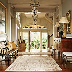 A wide entrance hall extends to the back of a Charleston house, designed by Amelia Handegan, for an unobstructed view.