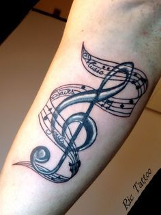 music tattoo... i want it so bad. =)