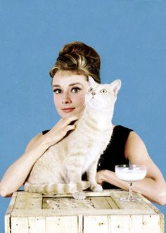 "Audrey Hepburn and her furry costar, ""Cat"", from Breakfast at Tiffany's, 1961. Photographs by Howell Conant."