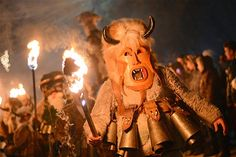 Bulgaria Carnival ~ Bulgarian kukeri dancers hold torches as they perform a ritual dance during the Kukeri Carnival in the village of Batanovci, Bulgaria. The Kukeri Carnival is a spring and fertility festival that falls between New Year's Day and Lent. The bells tied around the waist are intended to drive away evil spirits and sickness.