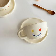 Smiley Cup and Saucer - ApolloBox Wine And Coffee Bar, Cool Gifts, Unique Gifts, Apollo Box, Ceramic Materials, Kitchen Cupboards, Barista, Smiley, Cup And Saucer