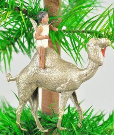 German Dresden ornament , a Cherub on a camel.