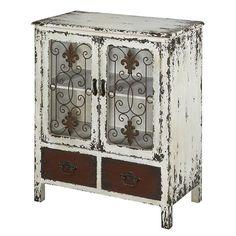 Distressed cabinet with fleur-de-lis accents.